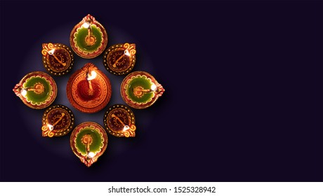 Diwali, Hindu festival of lights celebration. Clay diya colorful illuminated in Dipavali, Traditional oil lamps on dark background, top view, copy space