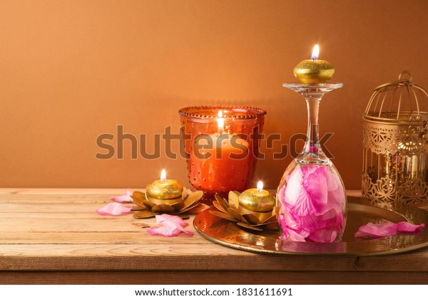 Diwali holiday home decorations on wooden table.