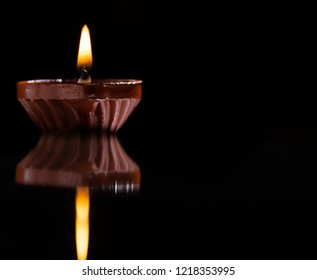 Diwali lamp also called as deepavali diyas or deepam used during the Indian festival, isolated against a dark background