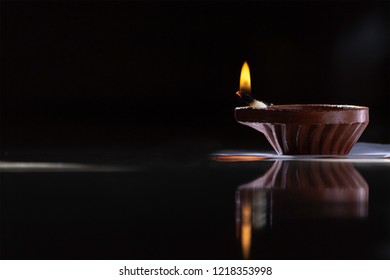 Diwali lamp or deepavali diyas or deepam used during the Indian festival, isolated against a dark background