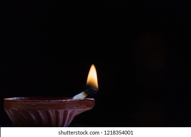 Diwali lamp often called as deepavali diyas or deepam used during the Indian festival, isolated against a dark background