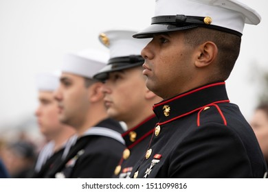 Dixon, California / USA - December 15, 2018: Service members standing at attention during the National Anthem at Wreaths Across America ceremony honoring past service men and women for the holidays.
