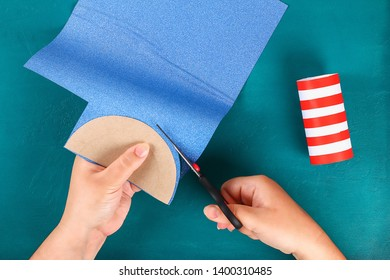 Diy 4th July petard toilet sleeve, paper, cardboard color American flag red blue white. Gift idea decor July 4, USA Independence Day. Step by step. Top view Process kid children craft. Workshop
