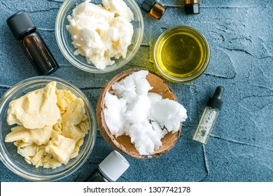 diy body butter with ingredients on concrete background