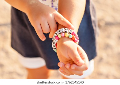 "DIY bracelet for children from square, round, colored beads with the words ""Love"" and ""Princess"". Decoration for little girls, hand-made bracelet, motor skills and creativity"