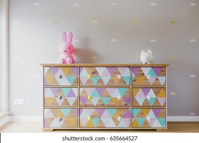 DIY colorful patterned commode with toys in pastel girl room