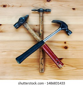 DIY concept for building & making stuff, for carpentry, woodwork, and do it yourself designs, emblems and industrial skills. Hammers, worn with pride.