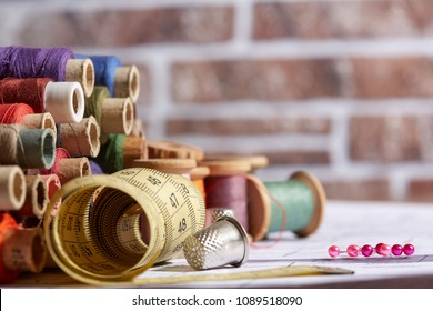 DIY concept. Sewing supplies: sewing thread, scissors, a spool of thread, pieces of cloth, needles,centimeter