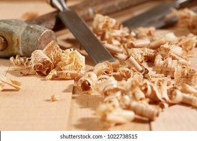 DIY concept. Woodworking and crafts tools. Carpentry hand tools on a workbench. Chisels, hammer, measuring tools.  Wooden parts, planks and stocks. Wooden background.