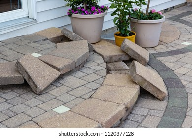 DIY construction replacing patio steps bricks with new curved paving stones laid out ready to use in a close up view