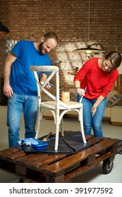 Diy couple renewing chair, painting wooden surface.