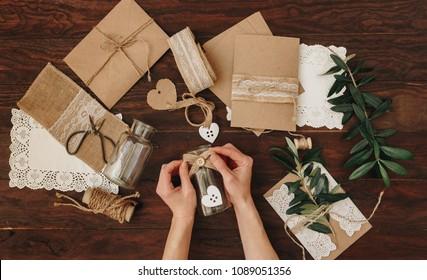 Diy creative  idea. Handmade card invitation. Wedding card invitation on wooden table. Flat lay