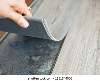 DIY easily renovating cover floor tiles by install PVC or polymer vinyl sheet on top , interior decoration design concept