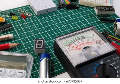 DIY electrical maker tools components on green cutting mat board. DIY electrical maker tools with copy space for text. DIY electrical maker concept.