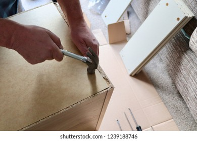 DIY in the home,flat pack wooden furniture .screw driver hammer