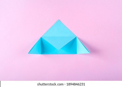 DIY and kid's creativity, origami. Step by step instruction: how to make bookmark easter bunny. Step5  Bend corners of triangle to middle. Easter craft