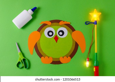 diy lantern for sankt martin day, traditional german feast, owl of color paper, glue, scissors, lanterns wand with light