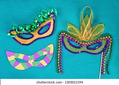 Diy Masquerade mask Mardi Gras, Fat Tuesday. Gift idea, decor Mardi Gras. Carnival mask cardboard, sequins, paper, beads. Step by step. process childrens crafts. Top view. Green yellow purple
