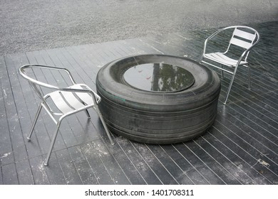 DIY outdoor table made of truck or airplane tire with stainless chair.