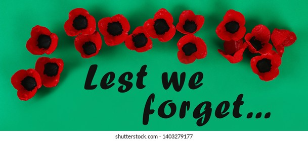 Diy paper red poppy Anzac Day, Remembrance, Remember, Memorial day on green background. Symbol war. Gift idea, decor. Copy space. Top view.