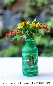 DIY Recycled Water Bottle Crafting Idea  for a Flower Vase
