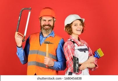 DIY repair. Construction workers. Home renovation. Couple renovating house. Woman builder hard hat. Man engineer or architect. Construction site. Interior renovation. Creating our family nest.