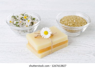 diy soap bar with fresh and dried chamomile flowers
