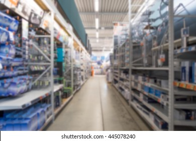 Diy store aisle with shelves out of focus.