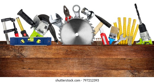 DIY tools collage concept behind wooden plank with copy space and circular saw blade isolated on white wide panorama background