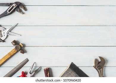 Diy tools on wooden background with copy space.