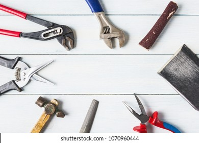 Diy tools over wooden background with copy space.
