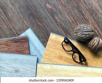 DIY vinyl sheet wood plank pattern choosing for home floor tiles renovation / Top view on composition space