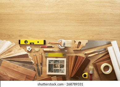 DIY workbench top view with carpentry and construction tools, copy space at top