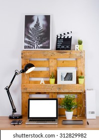 DIY workspace make with pallet. Computer blank on the desk