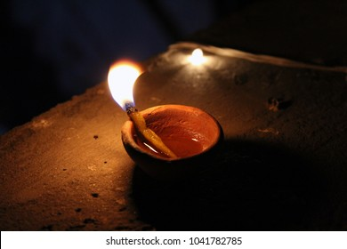 A Diya, Diyo, Deya, divaa, deepa, deepam, or deepak is an oil lamp used in India and Nepal, usually made from clay, with a cotton wick dipped in ghee or vegetable oils. Clay diyas are often used tempo