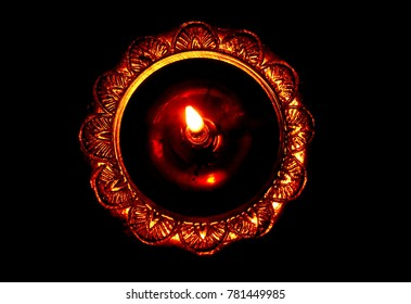 A Diya, Diyo, Deya, divaa, deepa, deepam, or deepak is an oil lamp used in India and Nepal, usually made from clay, with a cotton wick dipped in ghee or vegetable oils