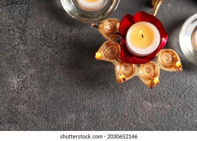Diya lamp for celebration of Divaly on dark background