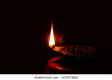 diya lamp for  indian hindu religious concept for ganesh puja  diwali new year or pongal greeting