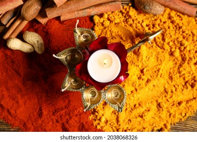 Diya lamp with spices for celebration of Divaly on table