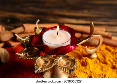 Diya lamp with spices for celebration of Divaly on table, closeup