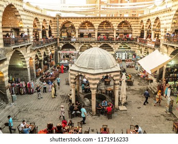 DIYARBAKIR, TURKEY - 25 AUG 2018: View of the Hasanpasa Khan, medieval historic building where people have breakfast and small shops, the central of Diyarbakir,