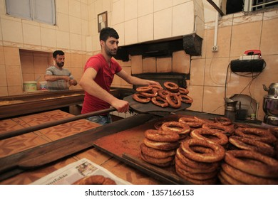 DIYARBAKIR, TURKEY- APRIL 29, 2015:  Simit master Yusuf Emsen, 5 staff to simit lovers with breakfast in the morning at 05.00 to grow the oven opens.