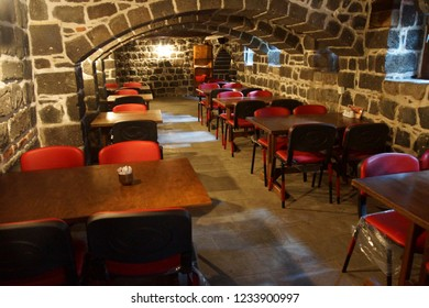 DIYARBAKIR, TURKEY - JUN 9, 2014 - Table and chairs in tea house  in a tower of the fortifications of  Diyarbakir, Turkey