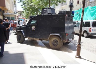 DIYARBAKIR, TURKEY - JUN 9, 2014 -Armored police car on guard in city street near the Syrian border