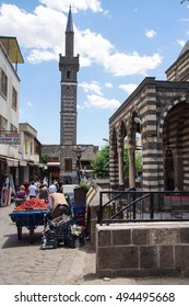 DIYARBAKIR, TURKEY - JUN 9, 2014 -Fruit vendors set up their cart in the old city of  Diyarbakir, Turkey
