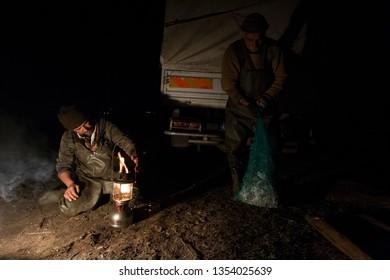 DIYARBAKIR,TURKEY-MARCH 15, 2014: Ömer Yılmaz, Şükrü Aslan and Seyhan Başboğa sell their frogs gathered at night in the hevsel gardens in Diyarbakır to a company in Adana.