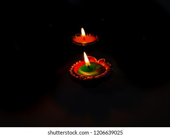 Diyas lit, decorated and arranged to celebrate Diwali.