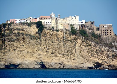 The dizzying rock face of the Island of Procida dominated by the Abbey of San Michele Arcangelo. Below the picturesque village of Abbey of San Michele Arcangelo.