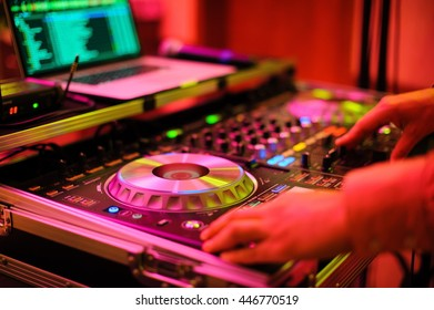 DJ CD player and mixer in nightclub