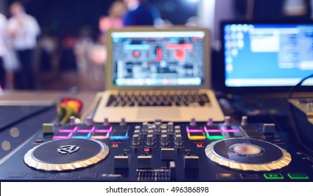 DJ CD player and mixer at wedding